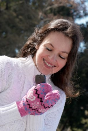 Portrait of happy woman with phone