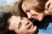 Happy young couple playing