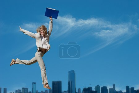 Photo for Successful business woman holding document folder - Royalty Free Image