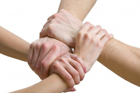 Photo for Four hands touching each other, close-up - Royalty Free Image