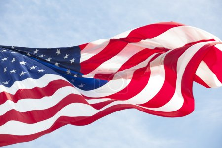 Photo for Photo of American flag waving in the wind - Royalty Free Image