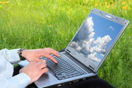 Photo for Laptop with blue sky on desktop - Royalty Free Image