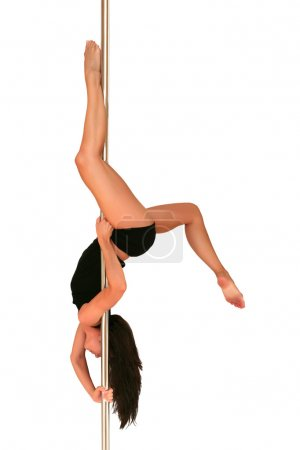 Photo for Young woman exercising pole dance fitness - Royalty Free Image