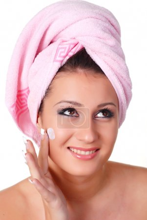 Photo for Portrait of woman in pink towel on her head - Royalty Free Image