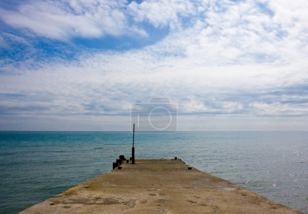 Pier on the sea and sky