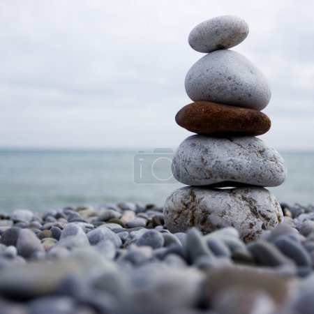 Photo for Cairn of stone at the beach of the sea - Royalty Free Image