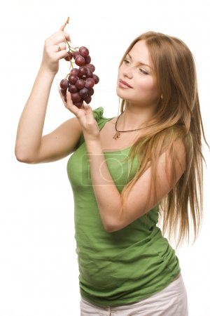 Woman and bunch of grapes