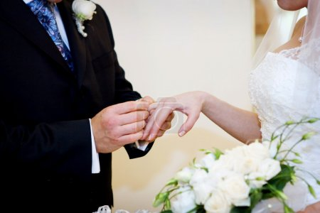 Photo for Young couple signing agreement of marriage - Royalty Free Image