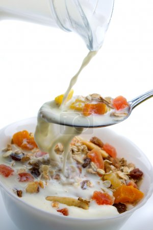 Dried fruit muesli served with milk