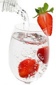 Strawberry fruit in a glass of water