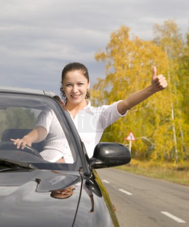 Photo for Young happy woman with her new car - Royalty Free Image
