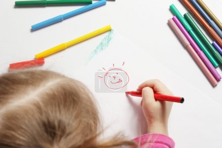 Photo for The girl draws bright and cheerful drawing - Royalty Free Image