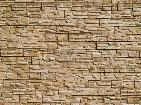 Photo for Rough decorative stone wall for a background - Royalty Free Image