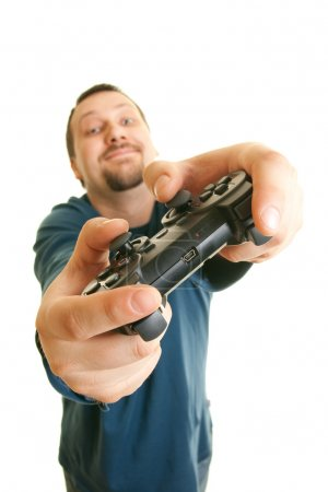 Young man holding joystick