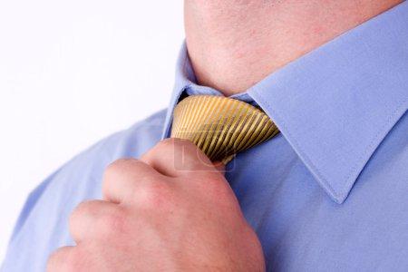 Adjusting his neck tie