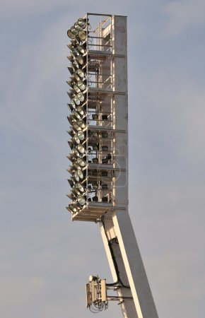Photo for Football ground floodlight tower with GSM antenna. - Royalty Free Image