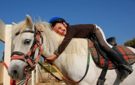 Photo for Little girl and her best friend white shetland pony - Royalty Free Image