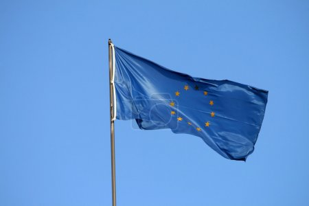 Photo for European union flag on the wind, yellow stars - Royalty Free Image