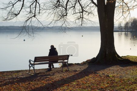 Photo for Lonely Man Sitting Next to a Lake - Royalty Free Image