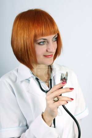 Woman doctor in a white coat