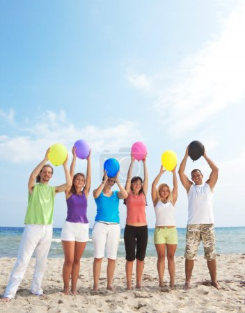 Happy holding balloons