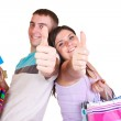 Happy young couple holding bags satisfied with thu...