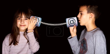 Photo for Boy and girl used the Internet communication - Royalty Free Image