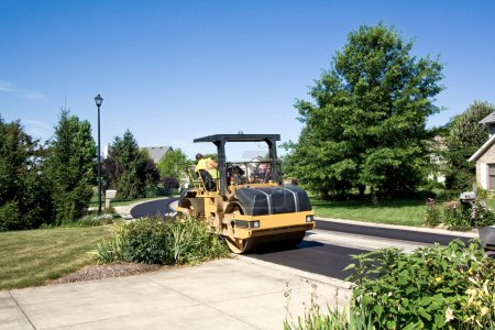 Steamroller smooths new asphalt