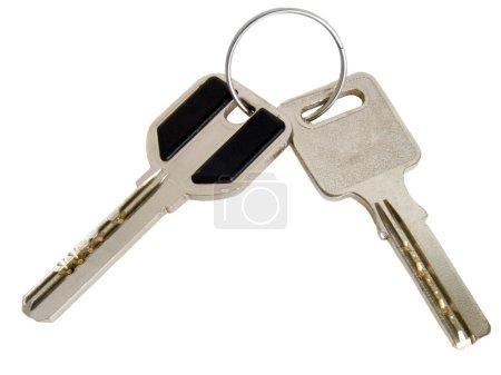 Photo pour Deux clés métalliques isolées sur fond blanc - image libre de droit