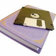 The book and diskette on a white background...