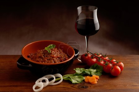 Ragu sauce and glass of wine