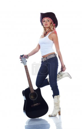 Teenager girl playing with a guitar