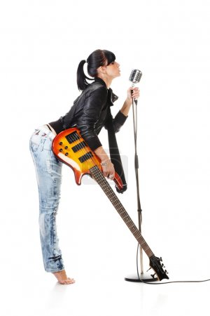 Rock-n-roll girl holding a guitar