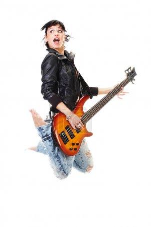 Beautiful rock-n-roll girl jumping