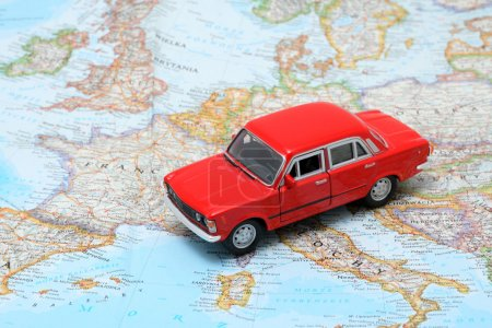 Photo for Tiny red car model on the map of Europe - Royalty Free Image