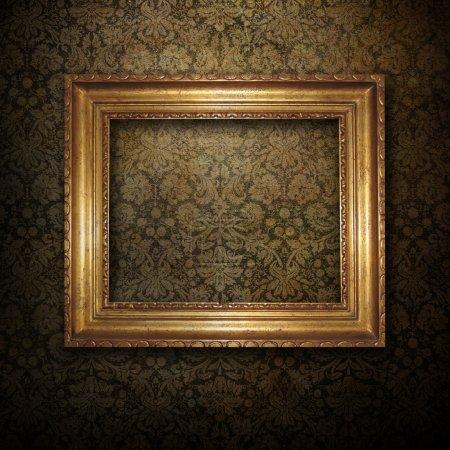 Photo for Golden frame over grunge wallpaper background - Royalty Free Image