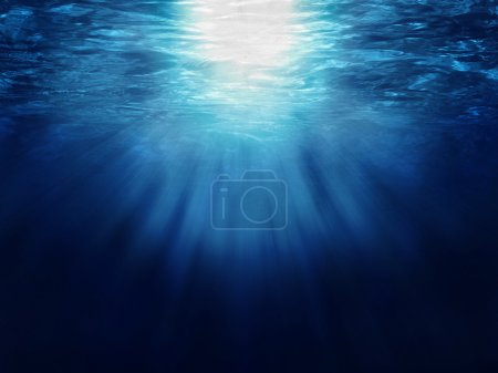 Photo for Looking up from under water, with sunrays streaming through water surface - Royalty Free Image