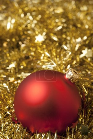 Photo for Red christmas ball on the golden tinsel. aRGB. - Royalty Free Image