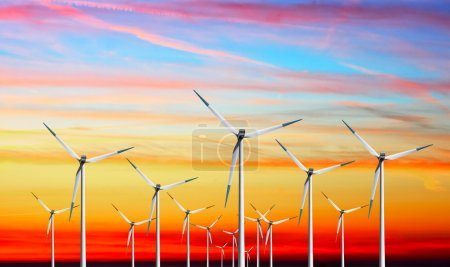 Wind turbines farm on sunset