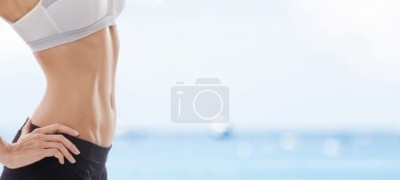 Photo for Close up view of well shaped woman's body in summer environment - Royalty Free Image
