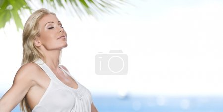 Photo for Portrait of young attractive woman having good time on the beach - Royalty Free Image