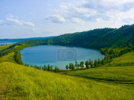 Lake in a hollow of a hill