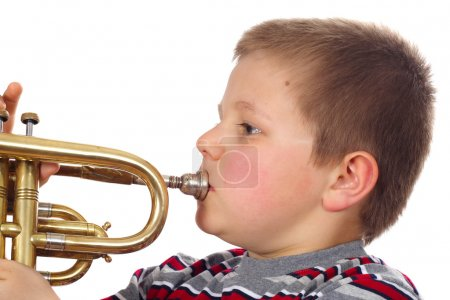 Photo pour Garçon Blowing Trompette photo sur le fond blanc - image libre de droit