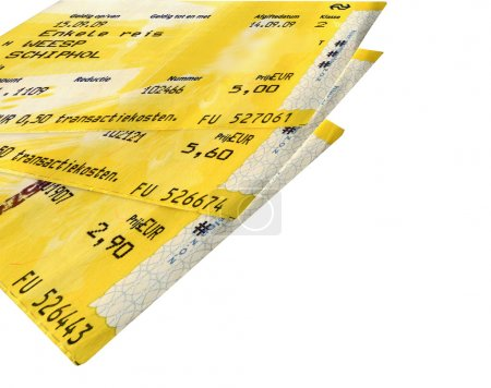 Few grunge yellow train tickets isolated