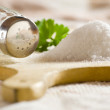 Sea salt on cloth and wooden plate in kitchen....