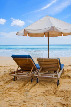Photo for Sun, umbrella and chairs on sandy beach in Bali, Indonesia. - Royalty Free Image