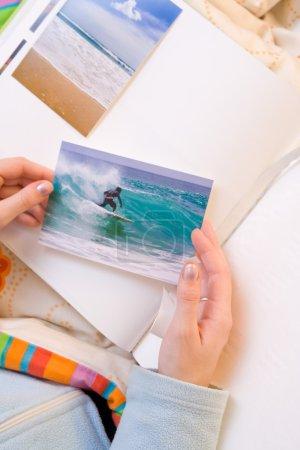 Sticking images to photo album