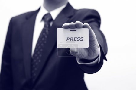 Press concept, Journalist is holding press id...