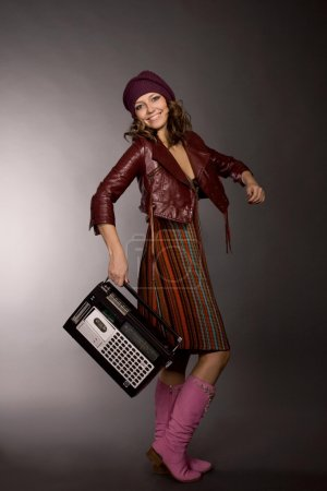 Photo for The happy girl with the tape recorder - Royalty Free Image