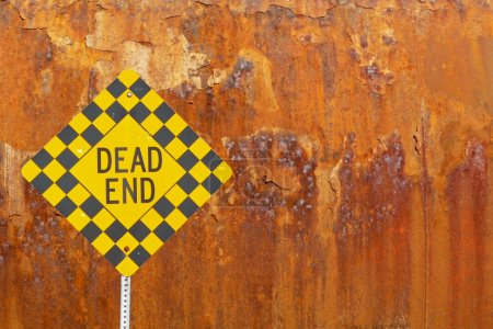 Dead end sign with rusted metal